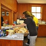 lara hall and helpers in kitchen